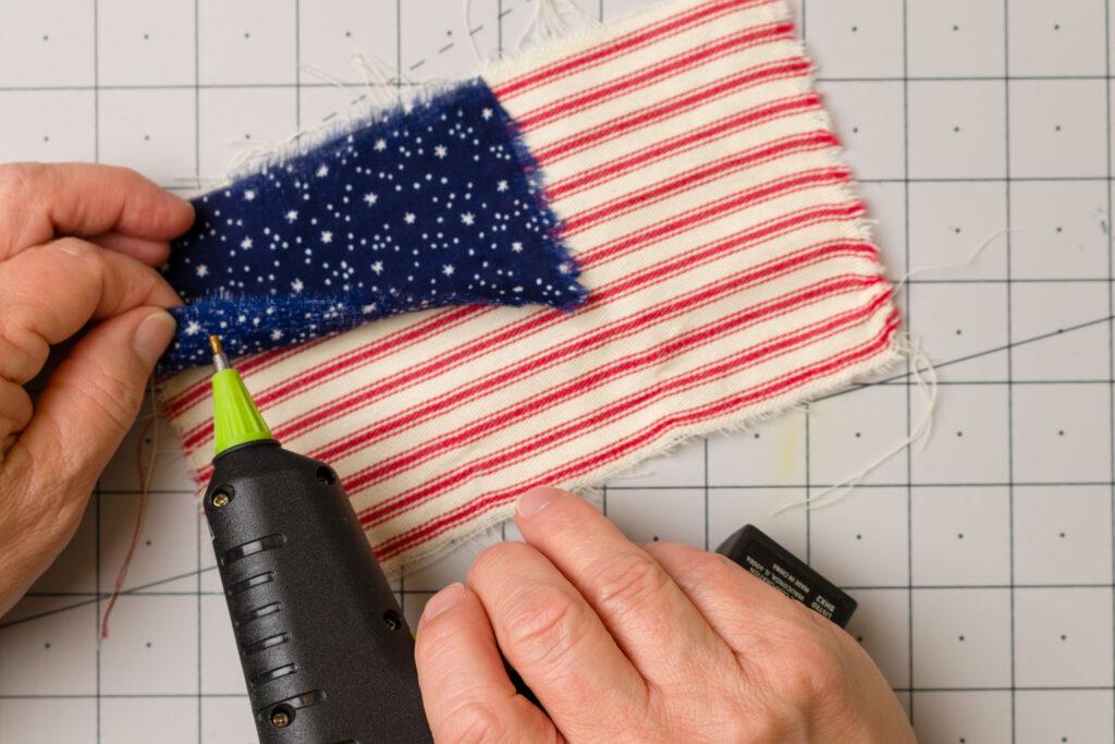 Glue flag pieces together