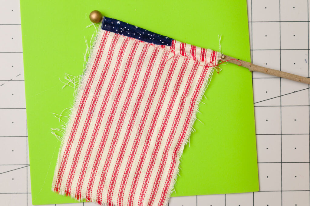 Glue flagpole fabric around the pole