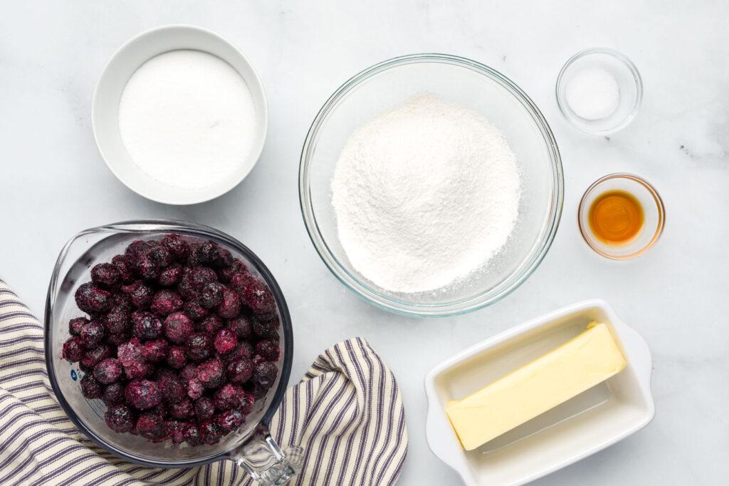 Blueberry Crisp ingredients in seperate bowls