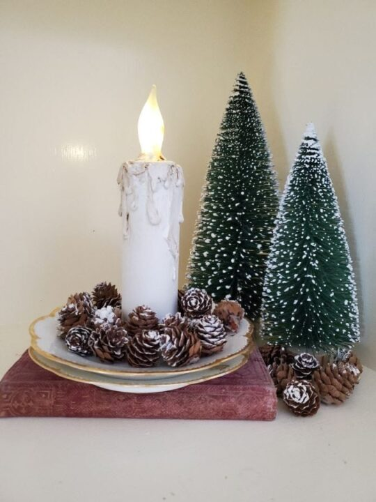 Handmade faux candle and bottle brush trees on a table