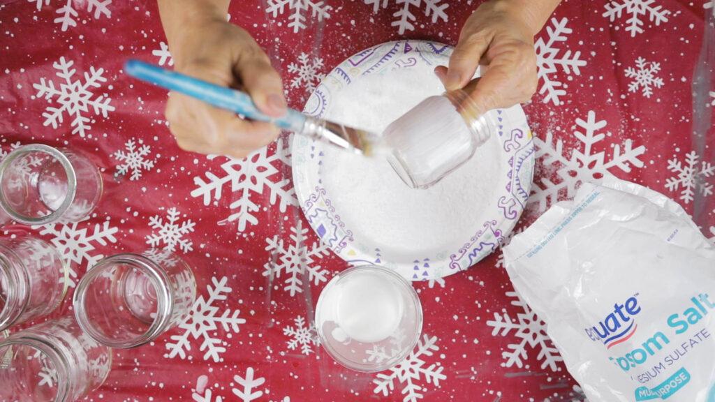 Painting Mod Podge on jar