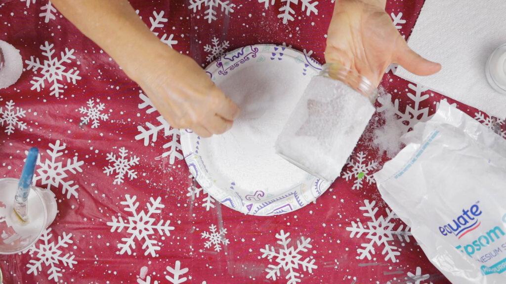 Sprinkling epsom salt over the jar with wet Mod Podge