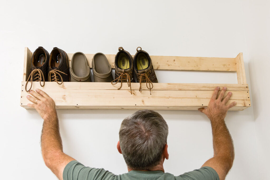 holding up a finished shoe rack to decide placement