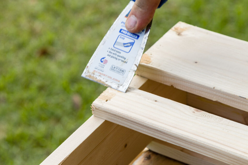 Filling the staple hole with wood filler