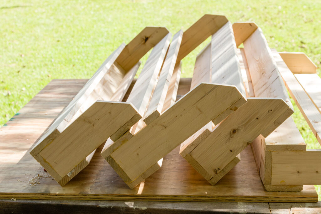 four finished shoe racks sitting on the board table before adding the a finish adding