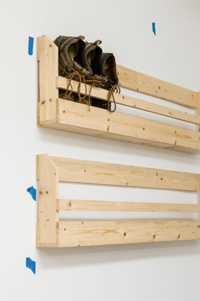 Installing the wall mounted shoe storage racks with screws into the studs