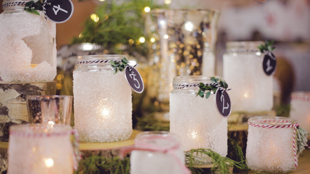 Christmas Candle holders sitting on wood slices on the table