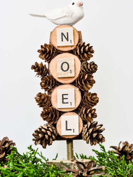 Christmas Noel Tree with wood slices and a white bird at the top
