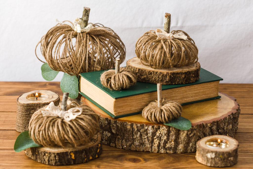 Fall vignette on wood slices and books on a wood table