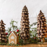PIne Cone Christmas Trees on the wood table with DIY wood houses and cedar