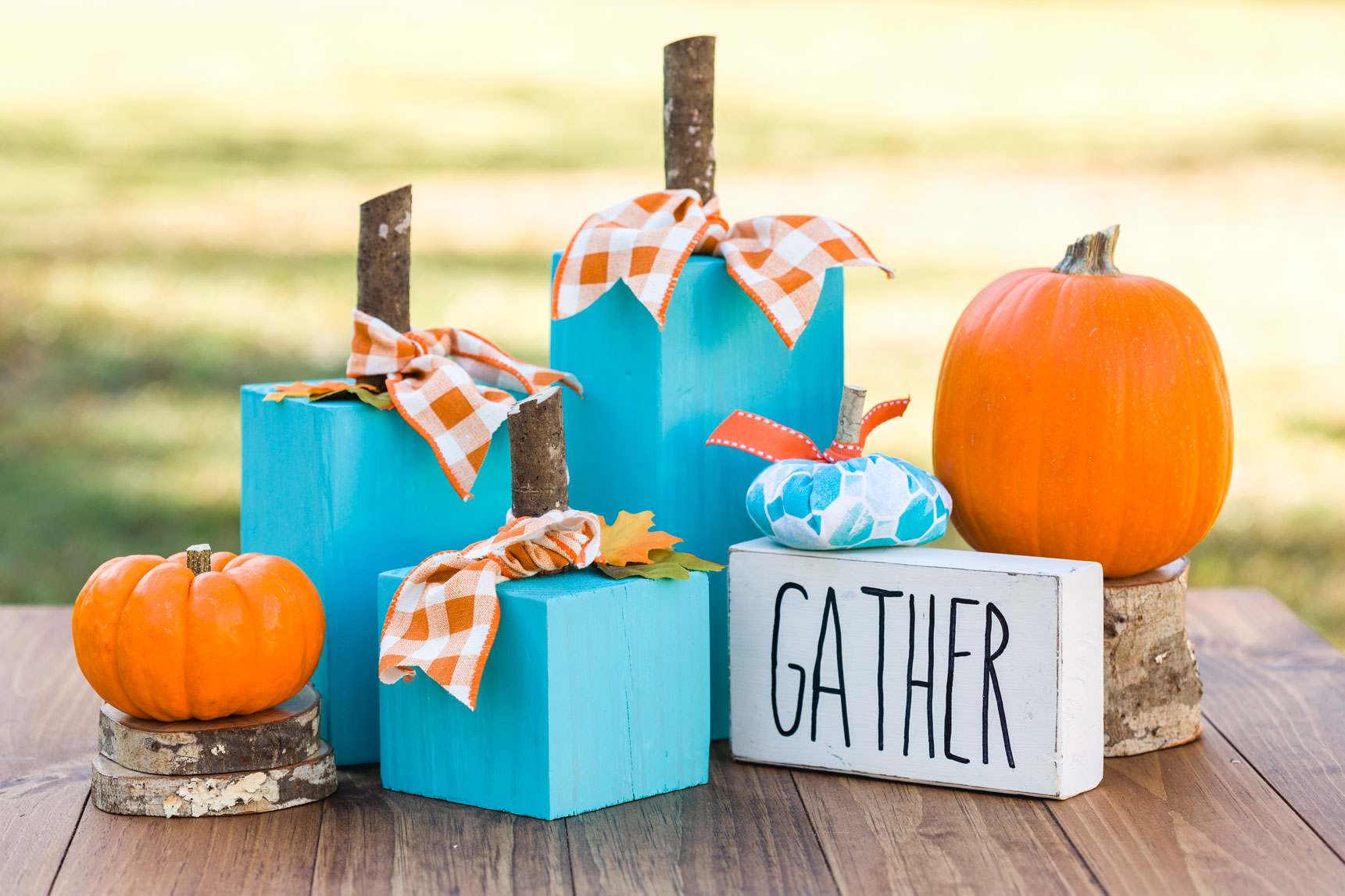 Turquoise Wooden Pumpkins on a wood table
