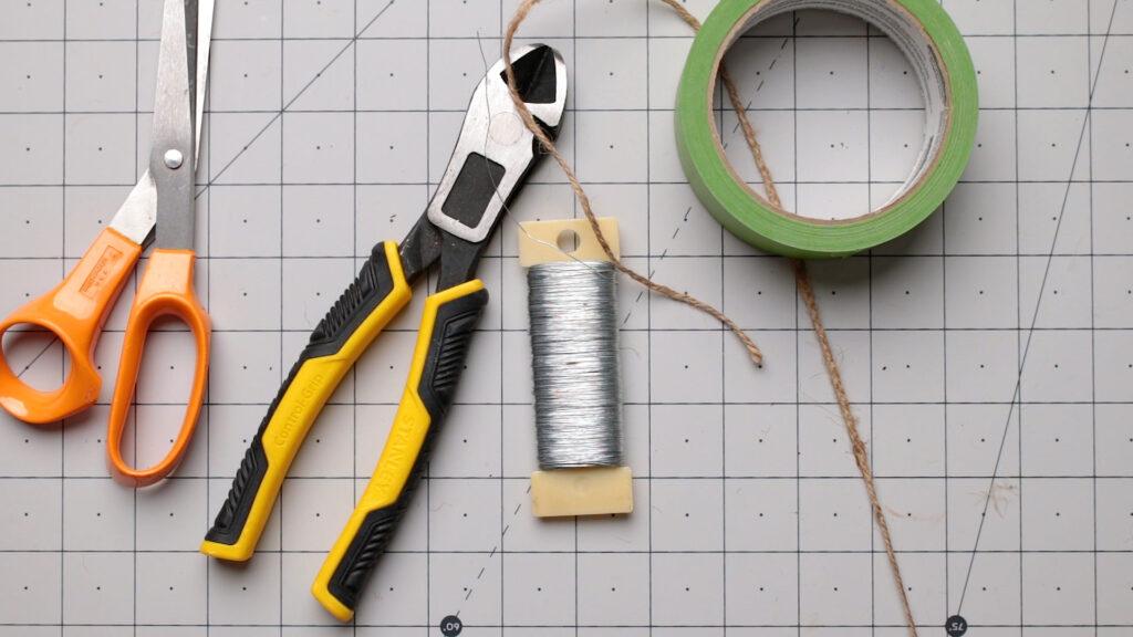 Supplies for making the hand wrap pumpkins on a craft mat