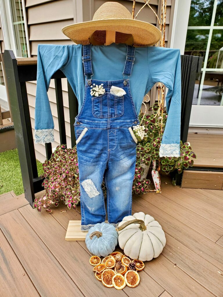 Blue jean overalls scarecrow on a porch