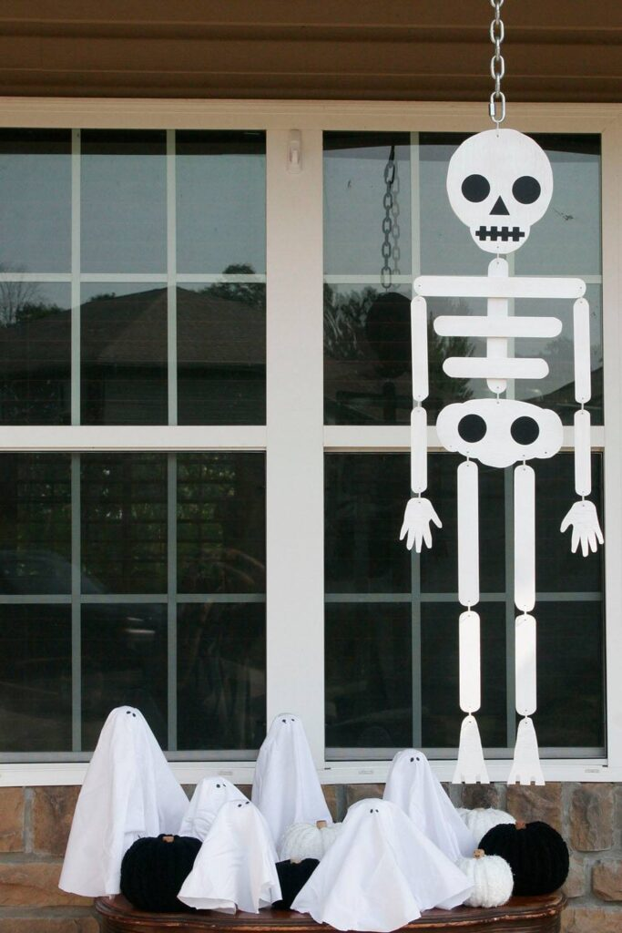 Handmade skeleton hanging from the porch roof