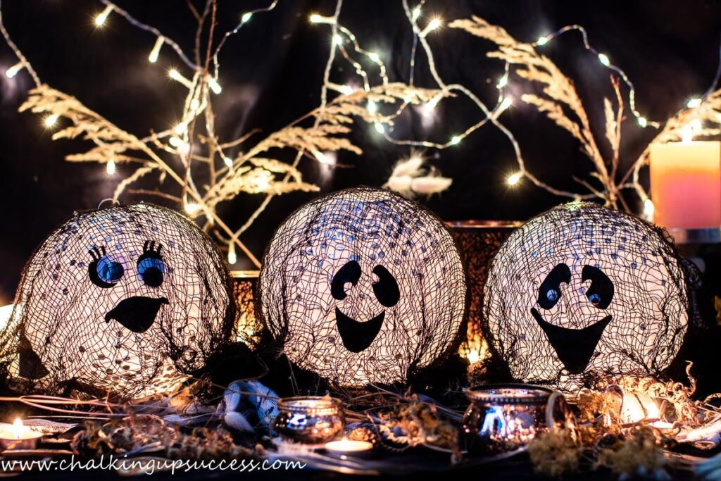 Handmade paper lanterns with ghosts faces
