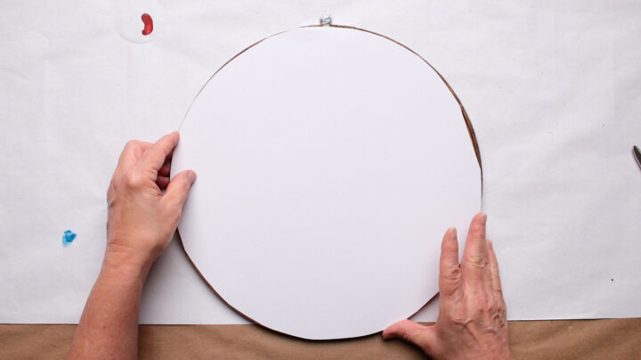 Checking the placement of my paper circle on the back of the hoops