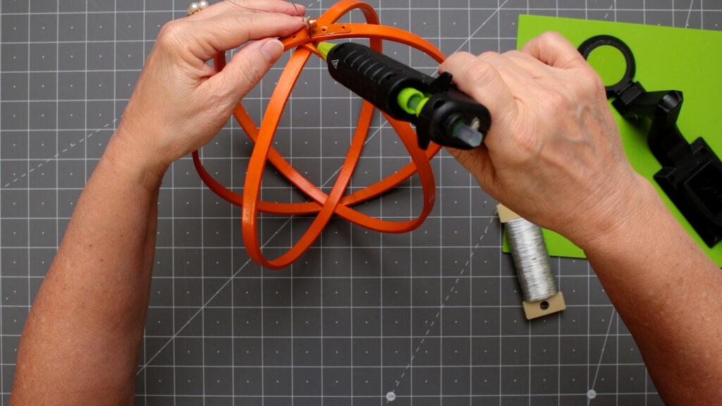 Adding a hot glue to top center on a craft mat