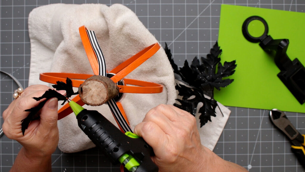 Attach leaves to the embroidery lantern