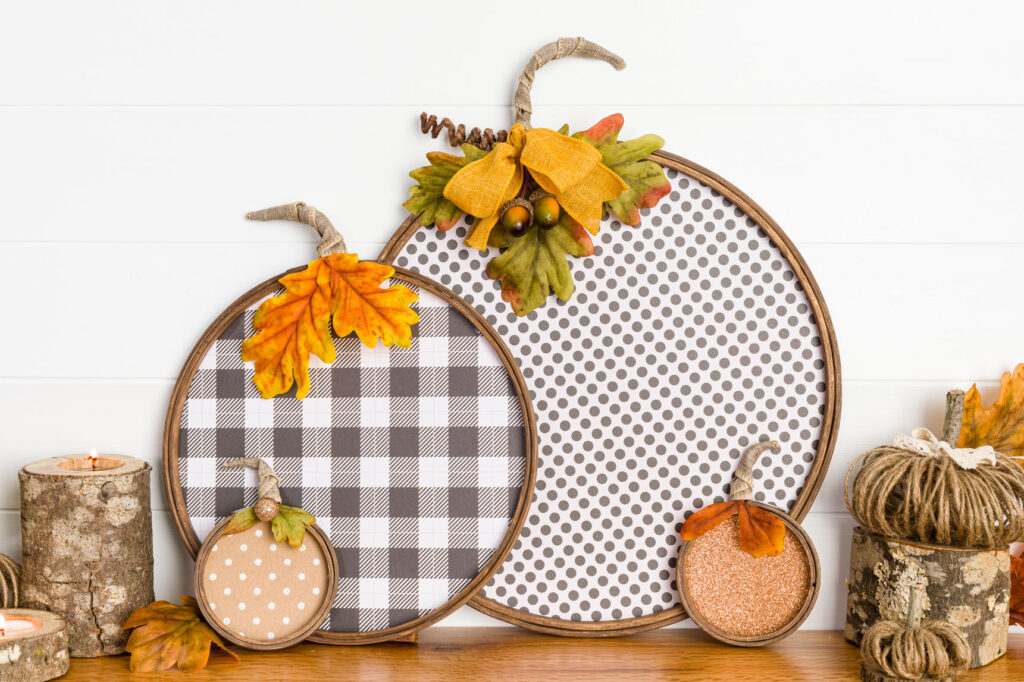 Paper pumpkin collection sitting on wood mantel