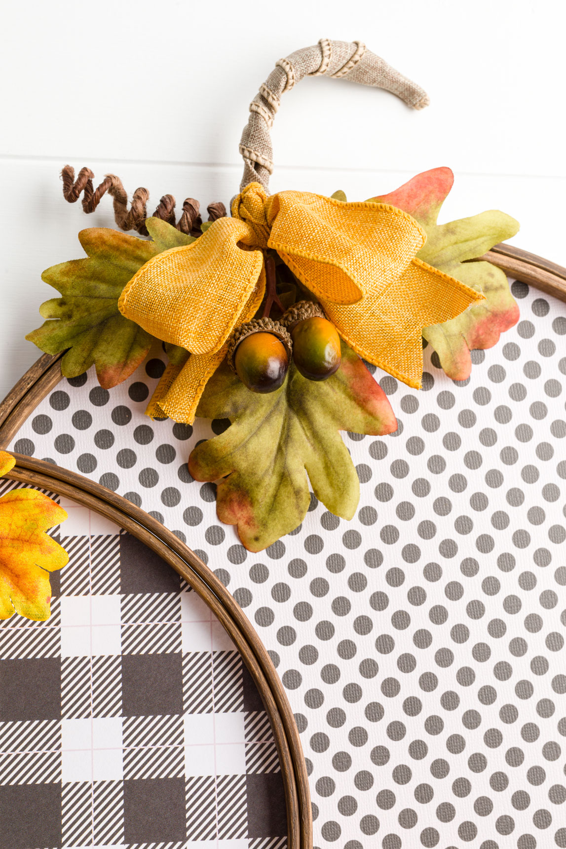 large paper pumpkin with bow, acorns, tendril, leaves and bow