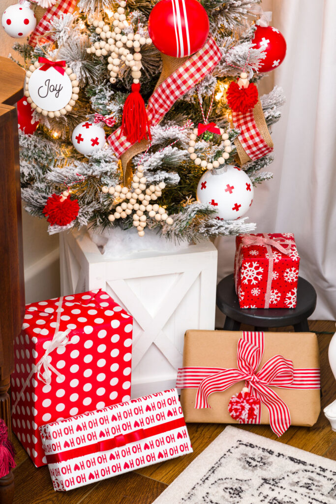 Red and white Christmas tree with gifts and ornaments