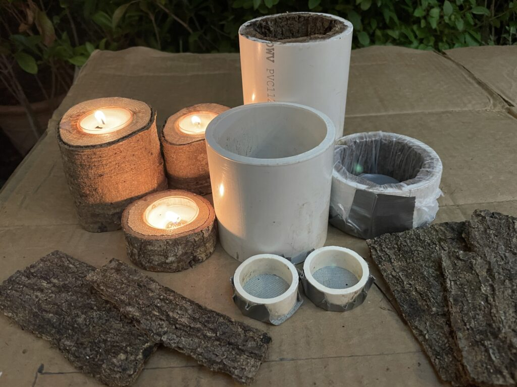 Concrete Mold Supplies and wooden candle holders sitting on a table