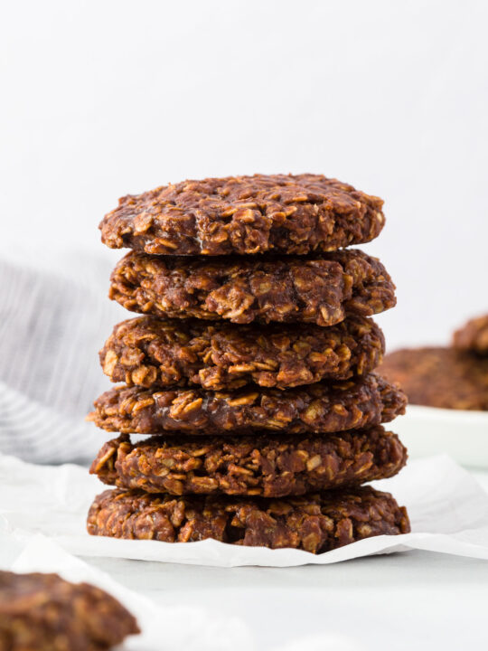 Chocolate no bake cookies stacked on a table