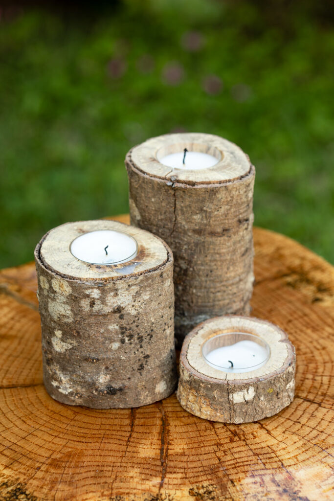 Handmade wooden candle holder with tealights sitting on a wooden table