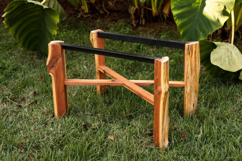 Handmade cedar table base sitting the grass