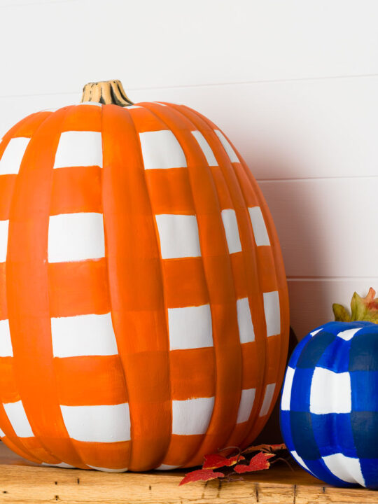 Buffalo plaid painted pumpkins in orange and blue